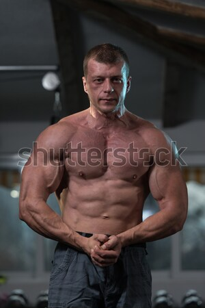 muscular bodybuilder showing his side triceps Stock photo © Jasminko