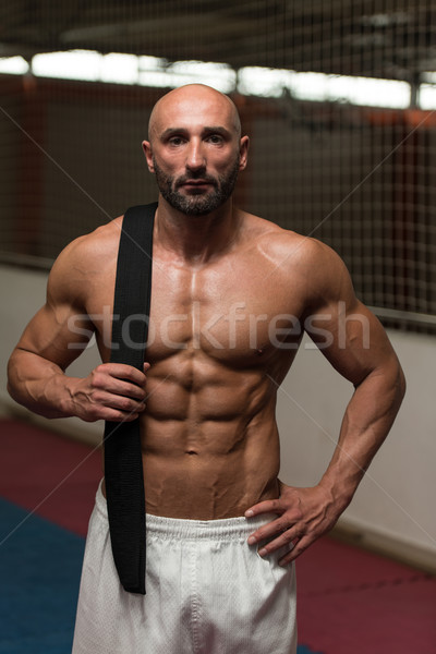 Sexy Muscular Man With Black Belt On Shoulder Stock photo © Jasminko