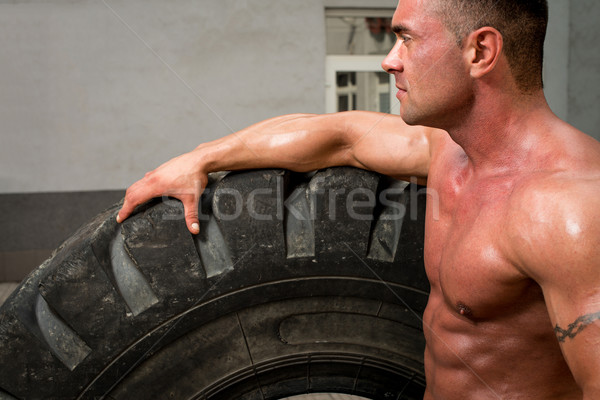 Bodybuilder Resting After Turning Tires Stock photo © Jasminko