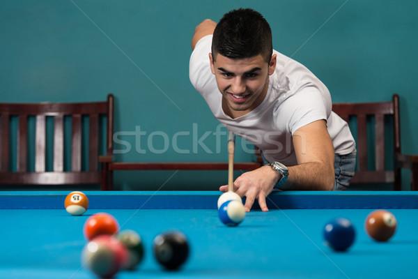 Adam oynama genç erkekler top bilardo masası spor Stok fotoğraf © Jasminko