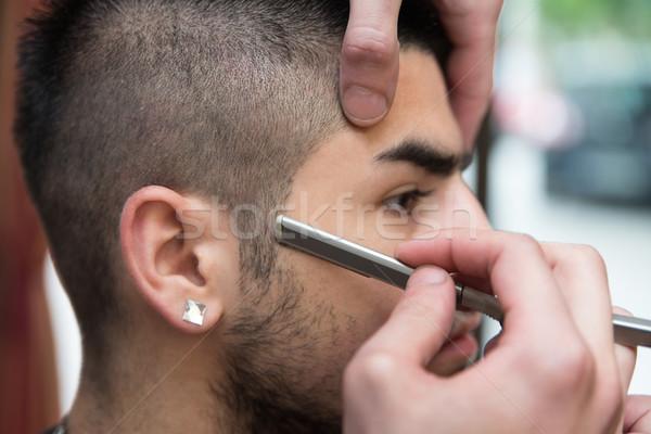 Fodrász áll egyenes borotva jóképű fiatal Stock fotó © Jasminko