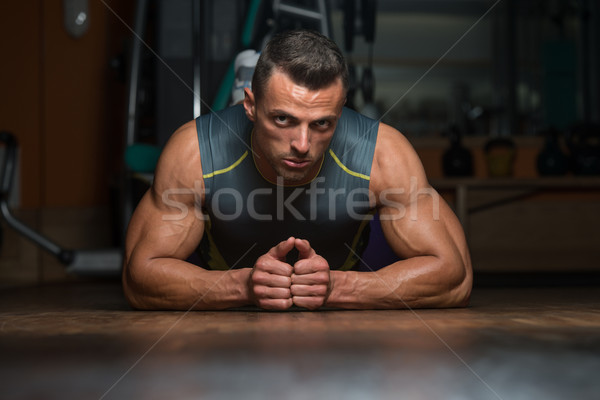 Young Man Doing Press Ups In Gym Stock photo © Jasminko