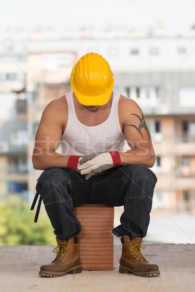 Paresseux homme construction travailleur de la construction détente air frais Photo stock © Jasminko