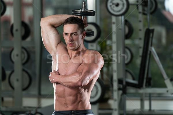 Kulturysta triceps hantle młodych sportowiec Zdjęcia stock © Jasminko