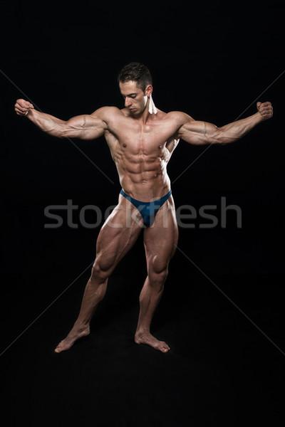 Ayakta güçlü genç vücut geliştirmeci kaslar Stok fotoğraf © Jasminko