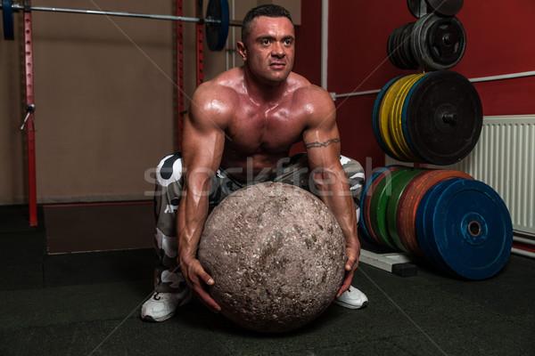 Bodybuilder Trying A Strongman Exercise Stock photo © Jasminko