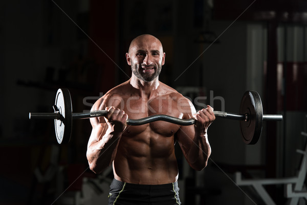 Mature Man Working Out In A Health Club Stock photo © Jasminko