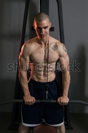 Muscular Men Flexing Muscles On Black Background Stock photo © Jasminko