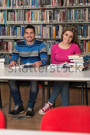 Mensen studeren bibliotheek portret knap studenten Stockfoto © Jasminko