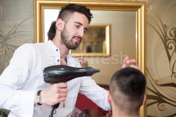 Hairdresser Blow Dry Man's Hair In Shop Stock photo © Jasminko