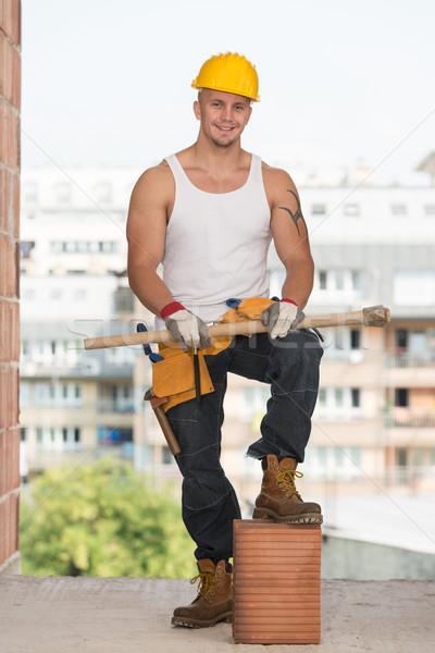 Portrait Of Handsome Engineer With Pickaxe Stock photo © Jasminko