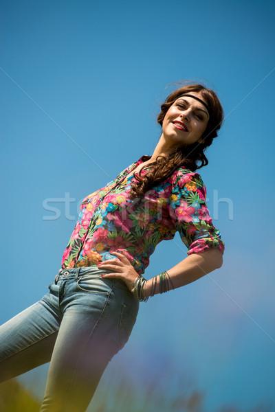beautiful woman in jeans standing on the grass Stock photo © Jasminko