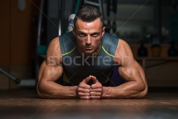 Jonge man jonge atleet bodybuilding Stockfoto © Jasminko