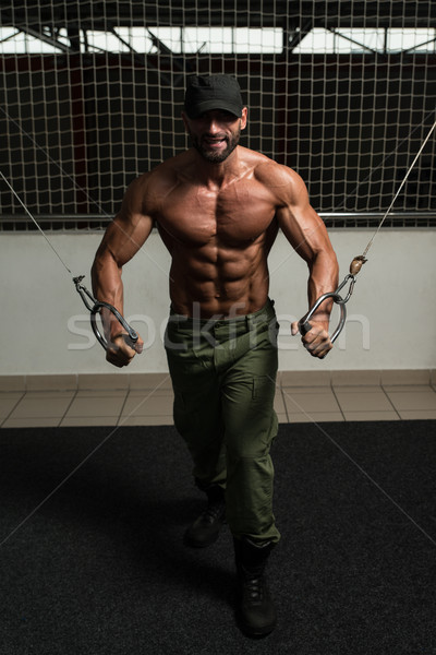 Mature Bodybuilder Is Working On His Chest Stock photo © Jasminko