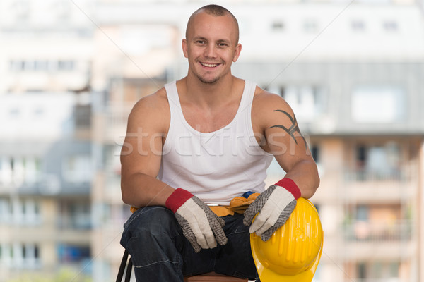Trabalhador sessão tijolo relaxante Foto stock © Jasminko