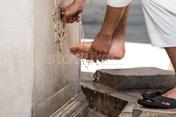 Muslim Washing Feet Before Entering Mosque Stock photo © Jasminko