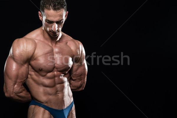Sérieux hommes permanent muscles jeunes bodybuilder Photo stock © Jasminko