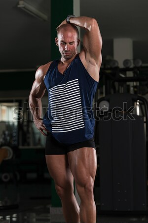 male bodybuilder posing in black shirt without sleeves Stock photo © Jasminko