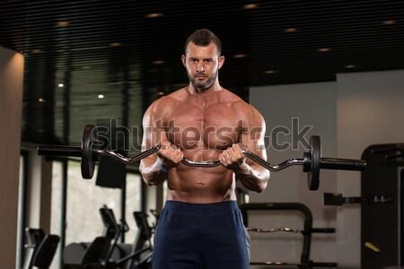 Reifer Mann Ausübung Langhantel Bizeps Gesundheit Stock foto © Jasminko