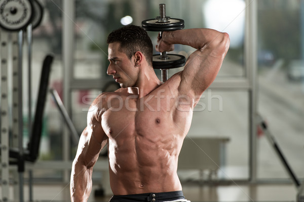 Młody człowiek wykonywania triceps młodych sportowiec Zdjęcia stock © Jasminko