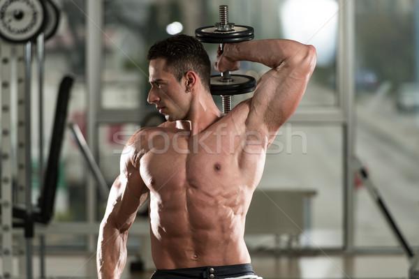 Jeune homme exercice triceps jeunes athlète Photo stock © Jasminko