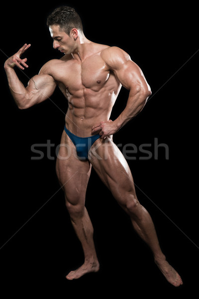 Serious Men Standing And Flexing Muscles Stock photo © Jasminko