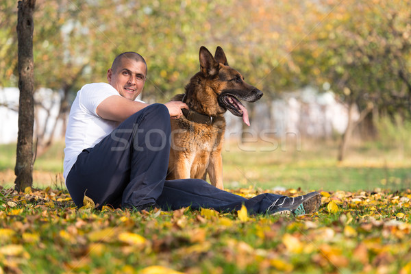 Adult Man Sitting Outdoors With His German Shepherd Stock photo © Jasminko