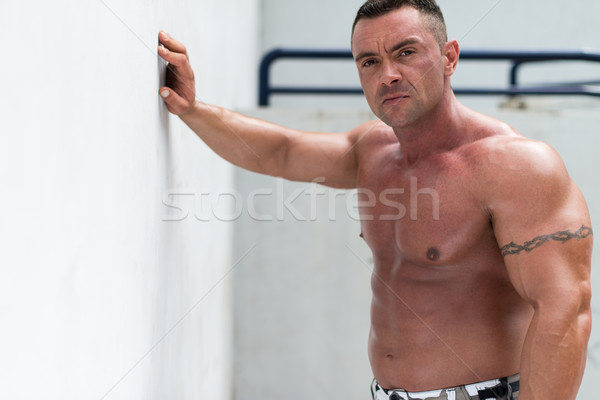 Muscular man, relaxation after work out Stock photo © Jasminko