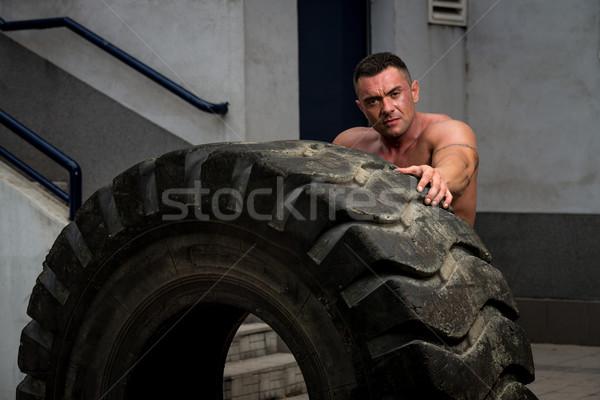 Muscular Man Resting After Tire Flip Stock photo © Jasminko