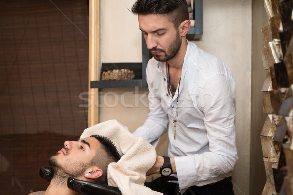 Washing Man Hair In Beauty Parlour Hairdressing Salon Stock photo © Jasminko