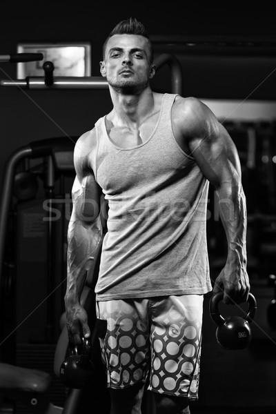 Muscular Man Exercise With Kettlebell Stock photo © Jasminko