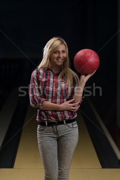 Women Holding A Bowling Ball Stock photo © Jasminko