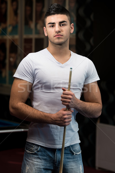 Portrait Of A Young Male Model Playing Billiards Stock photo © Jasminko