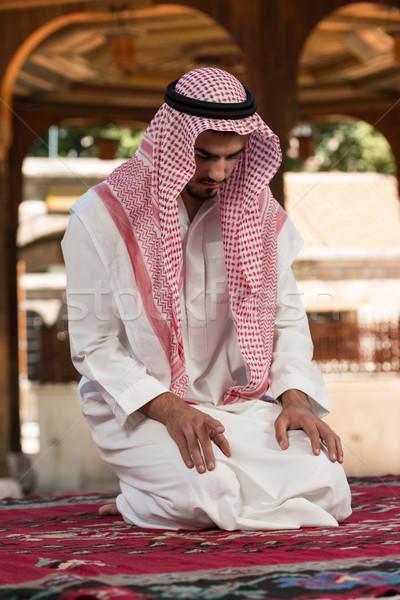 Fiatal muszlim férfi imádkozik készít hagyományos Stock fotó © Jasminko
