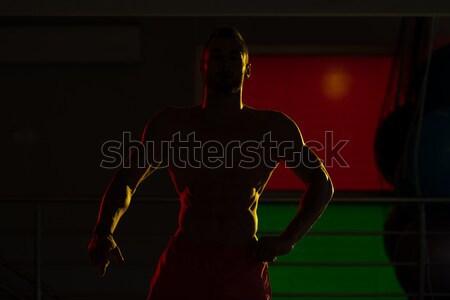 Siluet Muscular Man Flexing Muscles Stock photo © Jasminko