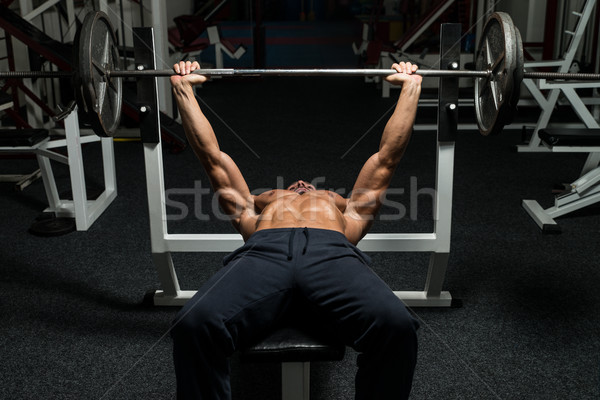Esforço banco imprensa homem maduro ginásio Foto stock © Jasminko