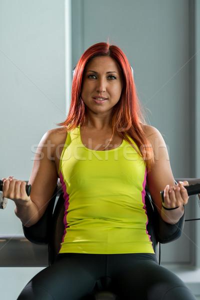 Kobieta wykonywania triceps kobiet sportu fitness Zdjęcia stock © Jasminko