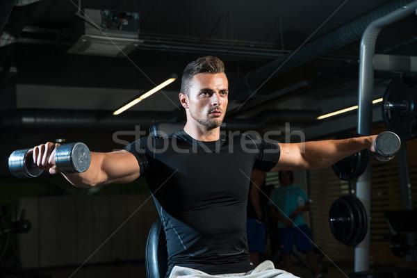 Schouder training lichaam metaal mannen macht Stockfoto © Jasminko