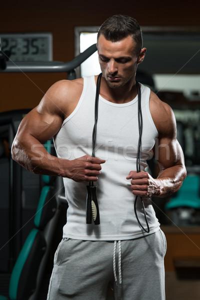 Jóképű izmos férfi ugrik kötél kardio Stock fotó © Jasminko