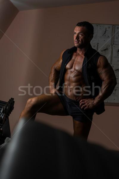 Masculino musculação posando preto camisas homem Foto stock © Jasminko