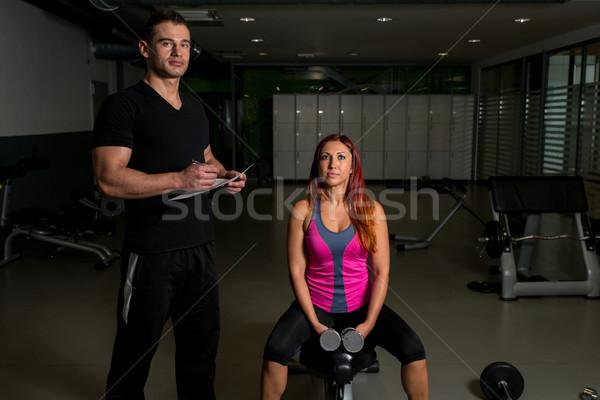 Personal Trainer Take Notes Stock photo © Jasminko