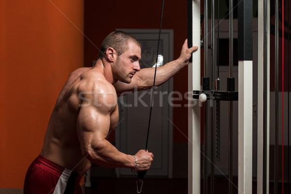 Bodybuilder triceps jeunes lourd poids Photo stock © Jasminko