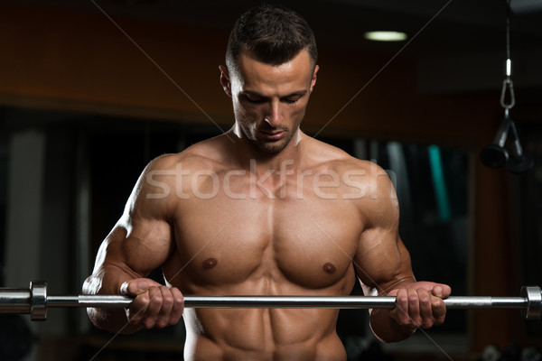 Young Man Exercise With Barbell Stock photo © Jasminko