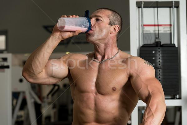 Bodybuilder With Protein Shaker Stock photo © Jasminko