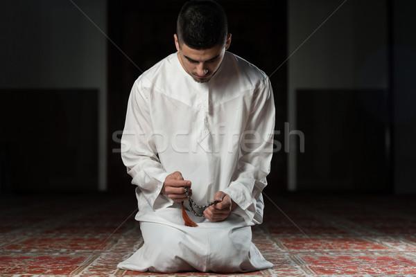 Young Muslim Man Praying Stock photo © Jasminko