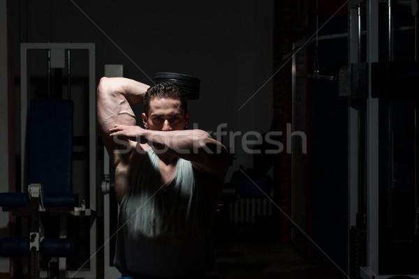 Gespierd mannen zwaar gewicht oefening triceps Stockfoto © Jasminko