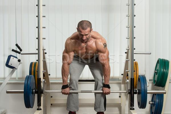 Bodybuilder zwaar gewicht oefening Maakt een reservekopie gezonde Stockfoto © Jasminko