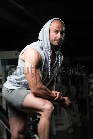 Bodybuilder Resting After Picking Up A Stone Stock photo © Jasminko
