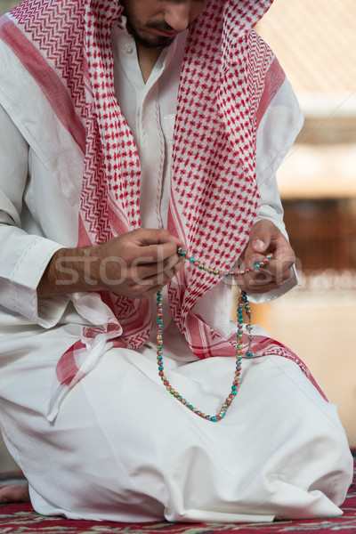 Close-Up Of Male Hands Praying With Rosary Stock photo © Jasminko