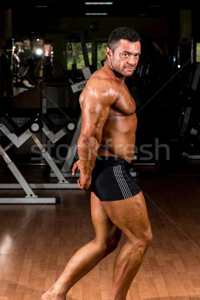 muscular bodybuilder showing his side triceps Stock photo © Jasminko